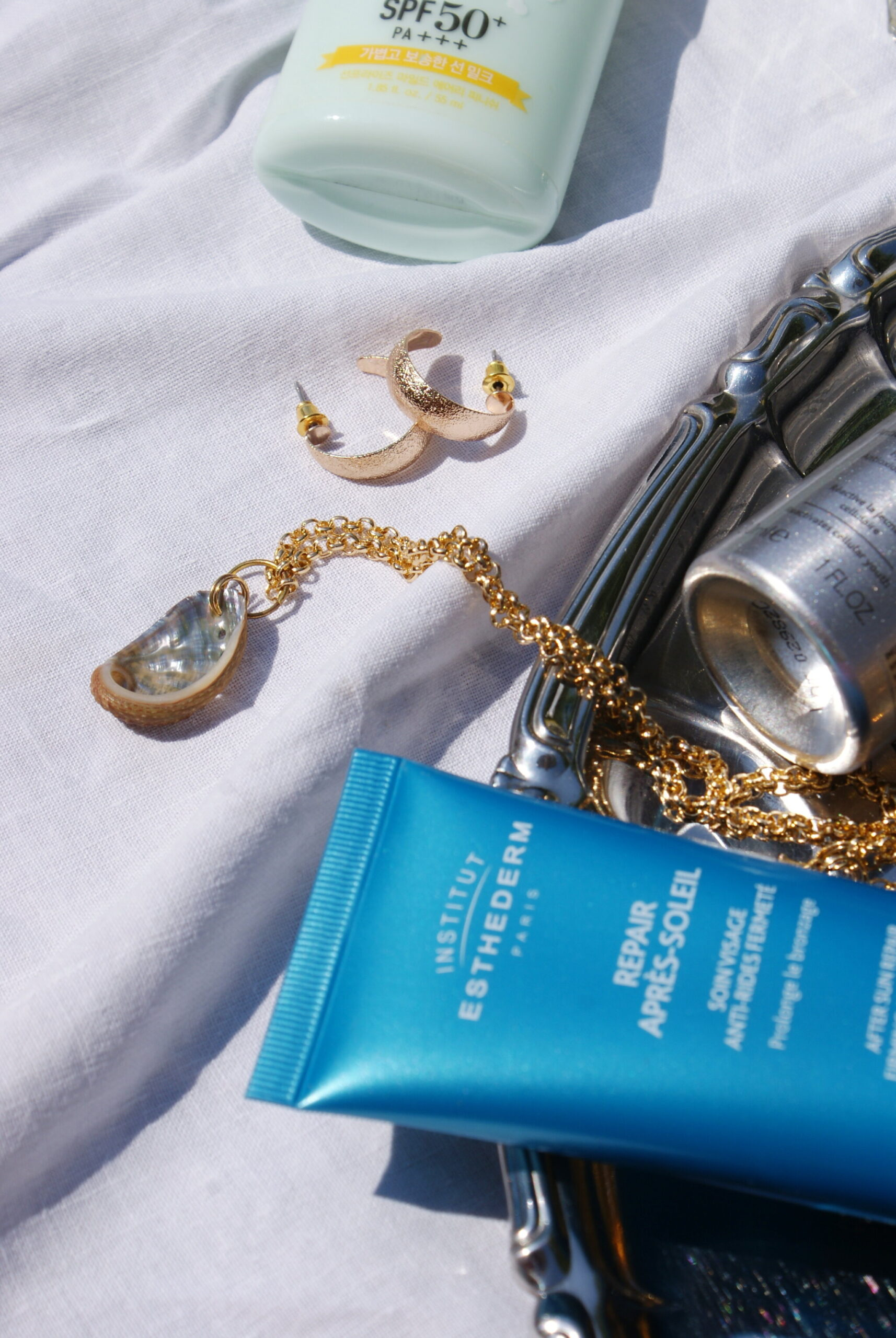 summer skincare flatlay aesthetic products review